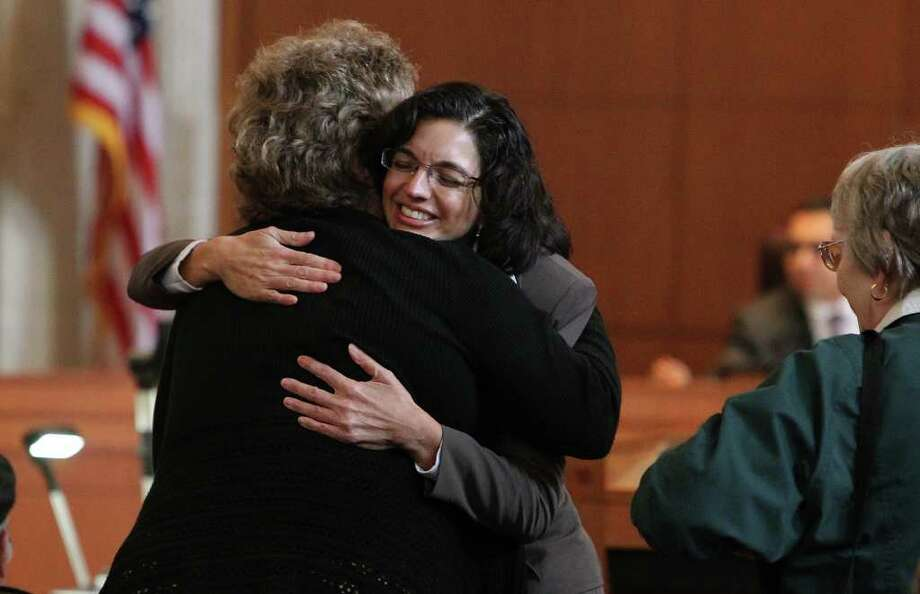 Newly appointed District 3 Councilwoman Leticia Ozuna hugs a suppporter after the City Council unanimously selected her for the position Thursday. Ozuna was a finalist with two other candidates, Rebecca Viagran and Terry Boyd. Ozuna will fill the position that was held by Jennifer Ramos, who stepped down to run for a seat on Bexar County Commissioner's Court. Photo: KIN MAN HUI, SAN ANTONIO EXPRESS-NEWS / San Antonio Express-News