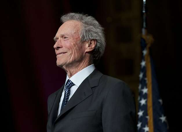 "Actor Clint Eastwood and California Hall of Famer listens during the California Hall of Fame ceremony on Thursday, Dec. 8, 2011 in Sacramento, Calif.   Ten legendary Californians, including astronaut Buzz Aldrin and basketball legend Earvin ""Magic"" Johnson, are being inducted into the state's Hall of Fame.  (AP Photo/The Sacramento Bee, Hector Amezcua)   MANDATORY CREDIT Photo: Hector Amezcua, Associated Press"
