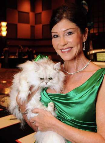 Patti Murphy holding Bella at the 25th Annual CAP Gala at the Hilton Americas Hotel Saturday Nov. 19,2011.(Dave Rossman/For the Chronicle) Photo: Dave Rossman / © 2011 Dave Rossman