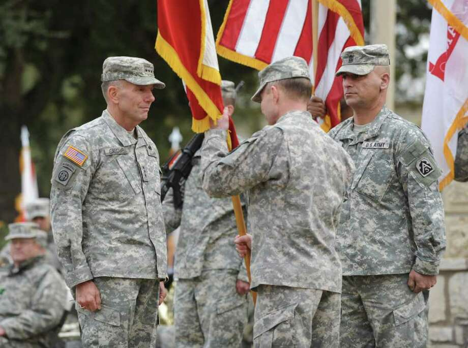 New Army North commander Lt. Gen. William Caldwell IV (left) receives the command flag from Gen. Charles H. Jacoby Jr., commander of North American Aerospace Defense Command and U.S. Northern Command, at Fort Sam Houston. Photo: BILLY CALZADA, SAN ANTONIO EXPRESS-NEWS / gcalzada@express-news.net