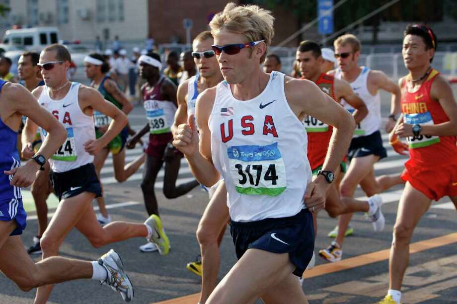 USA's  Ryan Hall, (3174) gets away from the starting line of the running of the men's Marathon at the 2008 Olympic games in Beijing, China on Sunday Aug. 24, 2008. Photo: Michael Macor / San Francisco Chronicle