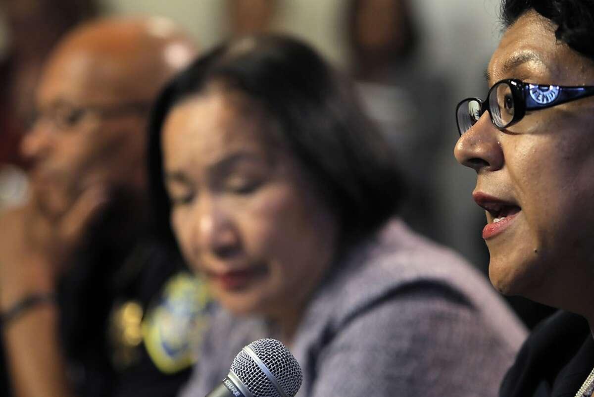 Oakland City Administrator Deanna Santana, right, answers a question during a press conference at City Hall in Oakland, Calif, on Wednesday, October 26, 2011. Oakland Mayor Jean Quan, center, interim Police Chief Howard Jordan, left, Santana anwered questions, Wednesday, after police used tear gas and non-lethal weapons against demonstrators from the Occupy Oakland group the previous night.