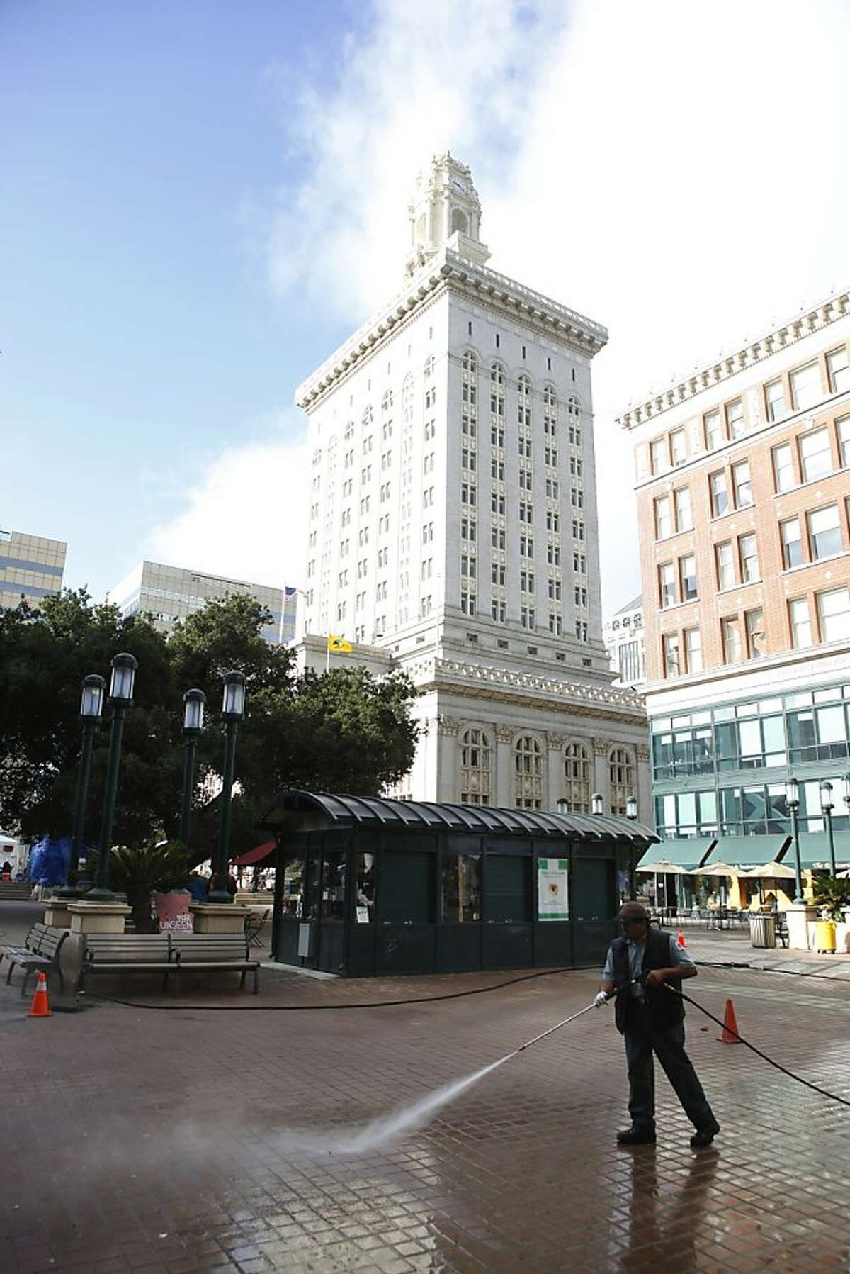 Clean0up crews power wash the Frank Ogawa Plaza the morning after Occupy Oakland's general strike near Oakland City Hall on Thursday, November 3, 2011 in Oakland, Calif.