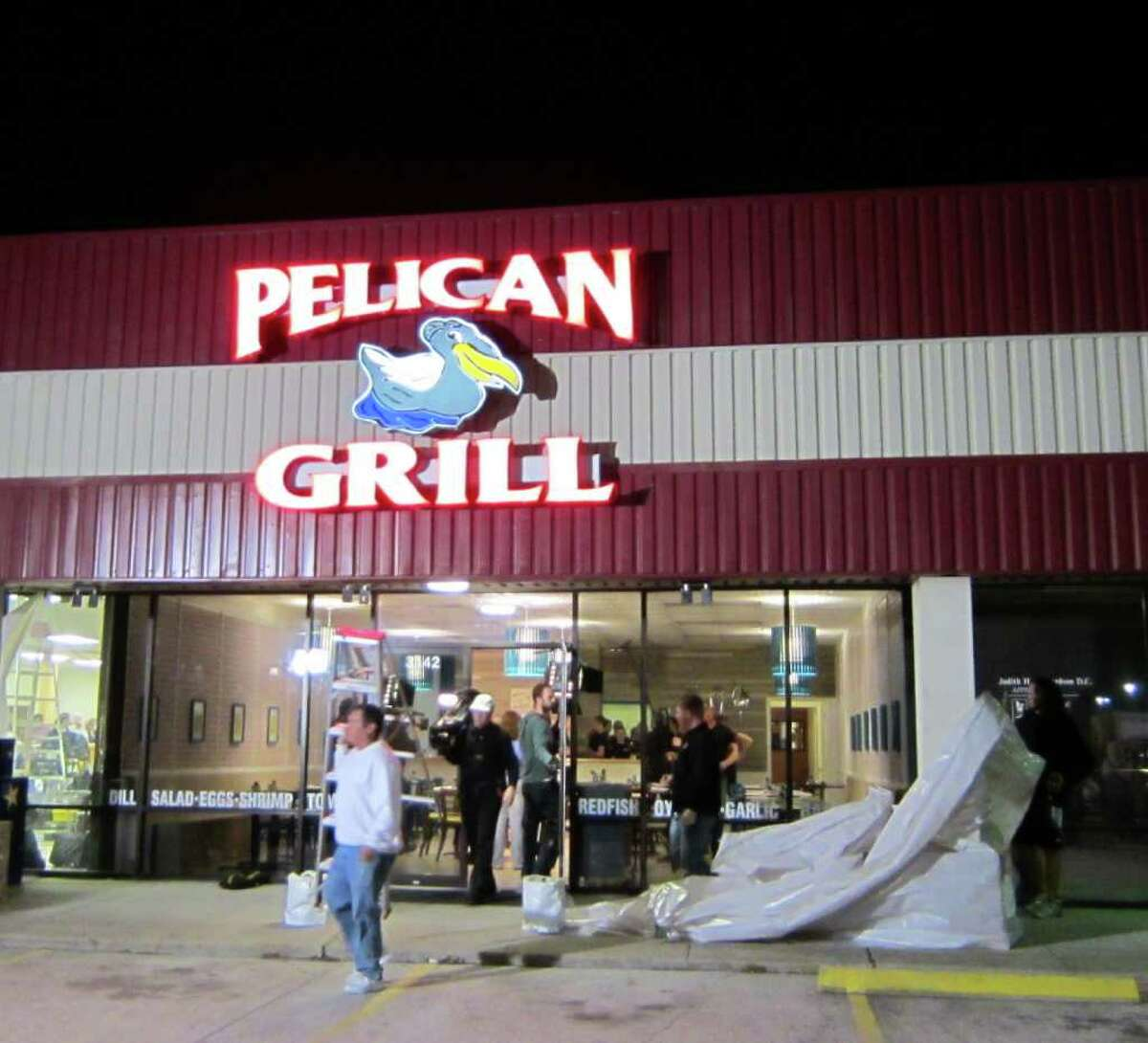 The Food Network's Restaurant Impossible remade the Pelican Grill in Seabrook for an upcoming episode of the reality show. The grand reopening was Jan. 11, 2012. A camera crew films diners. Crew remove the tarps that covered the restaurant for two days.
