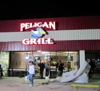 The Food Network's Restaurant Impossible remade the Pelican Grill in Seabrook for an upcoming episode of the reality show. The grand reopening was Jan. 11, 2012. A camera crew films diners. Crew remove the tarps that covered the restaurant for two days. Photo: Syd Kearney