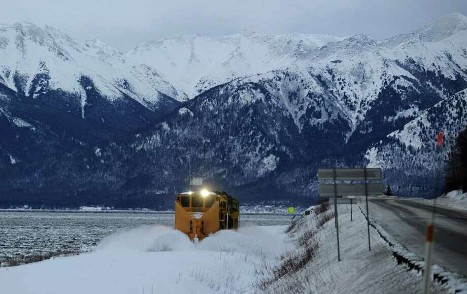 In this Wednesday, Jan. 11, 2012 photo, an Alaska Railroad plow clears the tracks along the Seward Highway next to Turnagain Arm near Bird in Anchorage, Alaska. Photo: Bob Hallinen, Associated Press / Anchorage Daily News