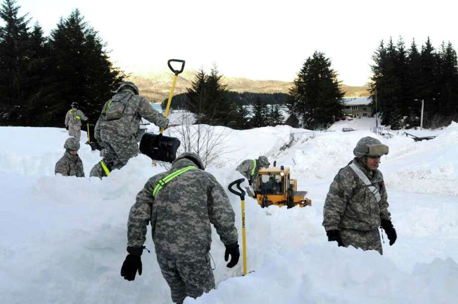 Alaska National Guardsmen are clearing roads and helping Cordova residents trapped in their homes by massive snows. / Alaska National Guard
