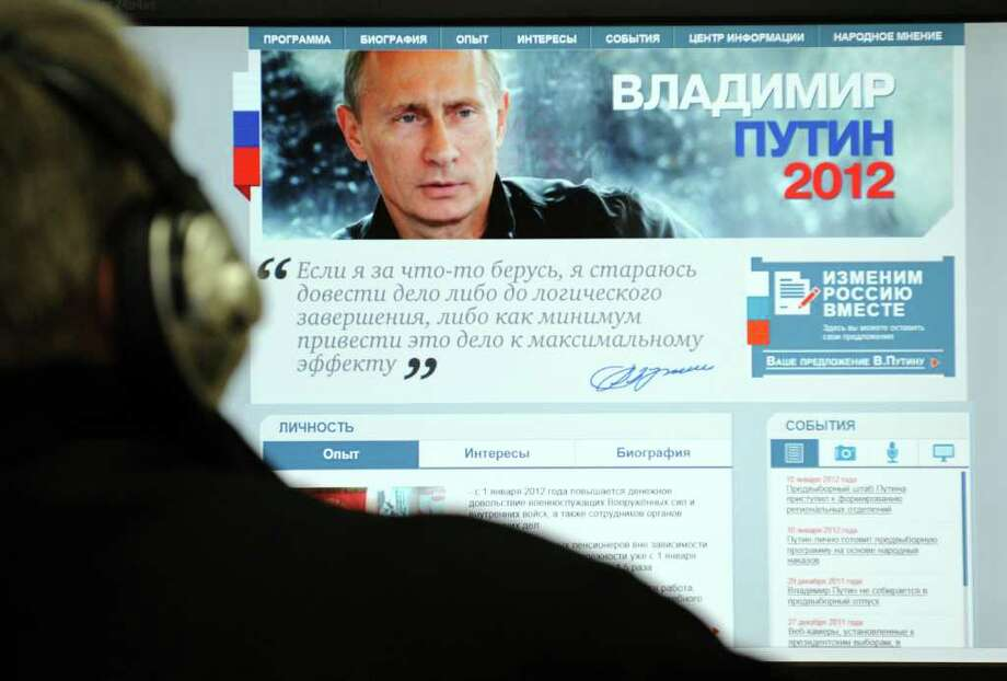 A  man looks at Russian Prime Minister Vladimir Putin's election Web site in Moscow on Thursday. Photo: YURI KADOBNOV / AFP