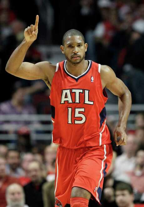 Atlanta Hawks' Al Horford celebrates after scoring a basket during the fourth quarter against the Chicago Bulls in Game 1 of a second-round NBA basketball playoff series in Chicago, Monday, May 2, 2011. The Hawks won 103-95. (AP Photo/Nam Y. Huh) Photo: Nam Y. Huh / AP
