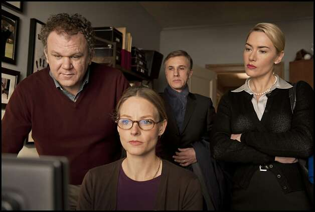 "Left to Right: John C. Reilly as Michael Longstreet, Jodie Foster as Penelope Longstreet, Christoph Waltz as Alan Cowan and Kate Winslet as Nancy Cowan appear in a scene from, ""Carnage."" Photo: Guy Ferrandis, Sony Pictures Classics"