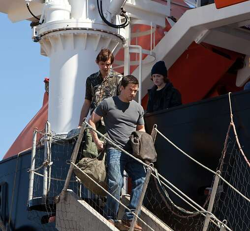"(L to R) Danny (LUKAS HAAS), Chris (MARK WAHLBERG) and Andy (CALEB LANDRY JONES) depart the ship in ""Contraband"", a white-knuckle action-thriller about a man trying to stay out of a world he worked hard to leave behind and the family he'll do anything to protect. Photo: Patti Perret, Universal Pictures"
