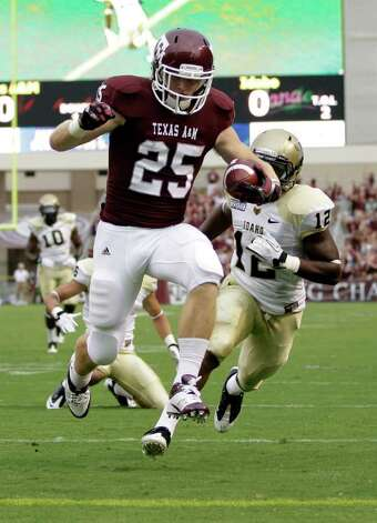 Texas A&M wide receiver Ryan Swope (25) leaps into the end zone for a touchdown as Idaho safety Quin Ashley (12) defends during the first quarter of an NCAA college football game, Saturday, Sept. 17, 2011, in College Station, Texas. Photo: AP