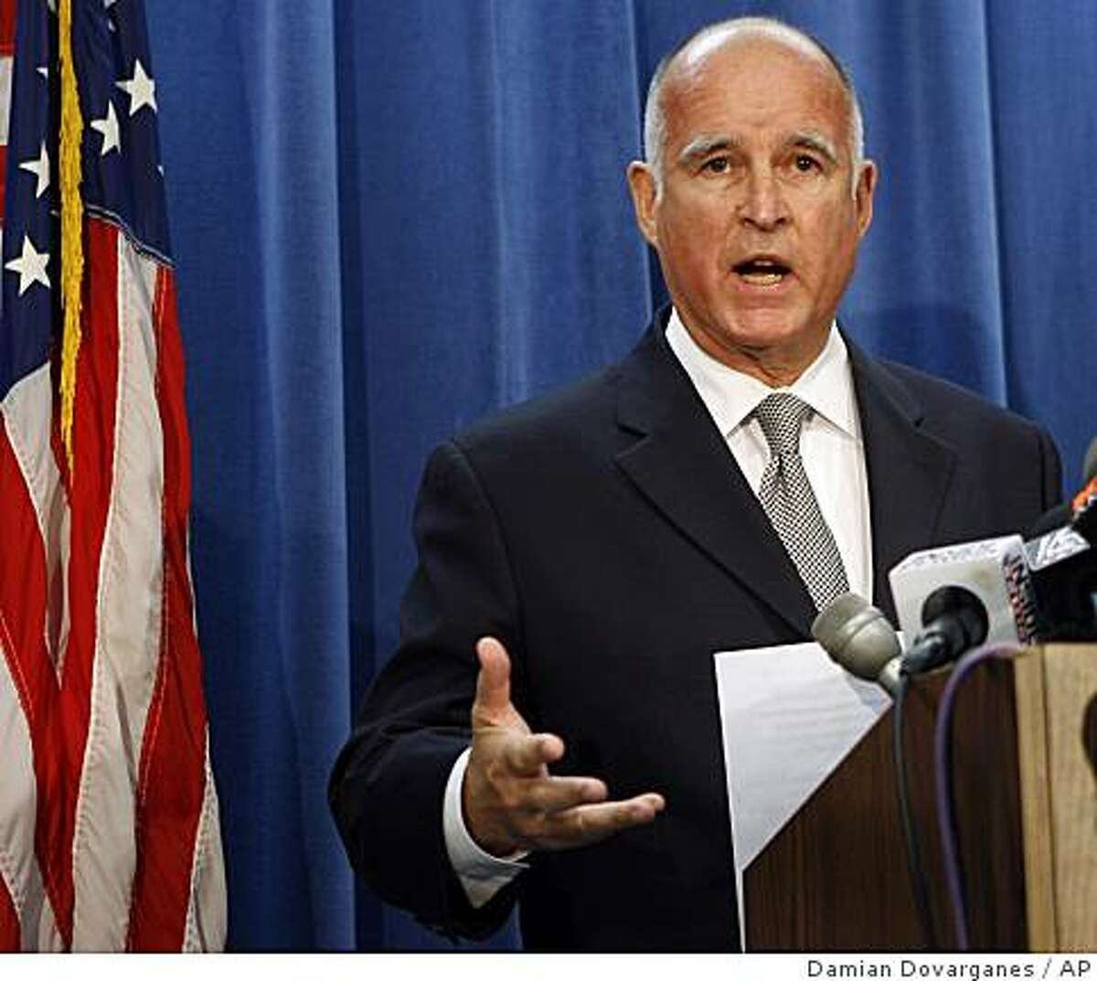 California Attorney General Jerry Brown comments on the death of Anna Nicole Smith during a news conference in Los Angeles Friday, Oct. 12, 2007. Authorities investigating the death of Anna Nicole Smith raided six locations Friday, including the offices and residences of two doctors, a spokeswoman for the Los Angeles County district attorney's office said. (AP Photo/Damian Dovarganes)