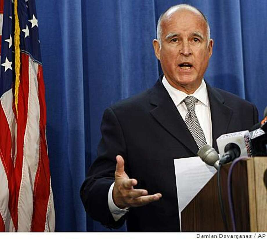 California Attorney General Jerry Brown comments on the death of Anna Nicole Smith during a news conference in Los Angeles Friday, Oct. 12, 2007. Authorities investigating the death of Anna Nicole Smith raided six locations Friday, including the offices and residences of two doctors, a spokeswoman for the Los Angeles County district attorney's office said. (AP Photo/Damian Dovarganes) Photo: Damian Dovarganes, AP