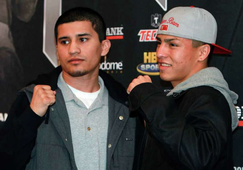 Adam Lopez (left)  and Ivan Najera stand together as they appear at a news conference to announce participation in a boxing event on February 4 at the Alamodome. Photo: TOM REEL, SAN ANTONIO EXPRESS-NEWS / © 2012 San Antonio Express-News  MAGS OUT; TV OUT; NO SALES; SAN ANTONIO OUT; AP MEMBERS ONLY; MANDATORY CREDIT; EFE OUT