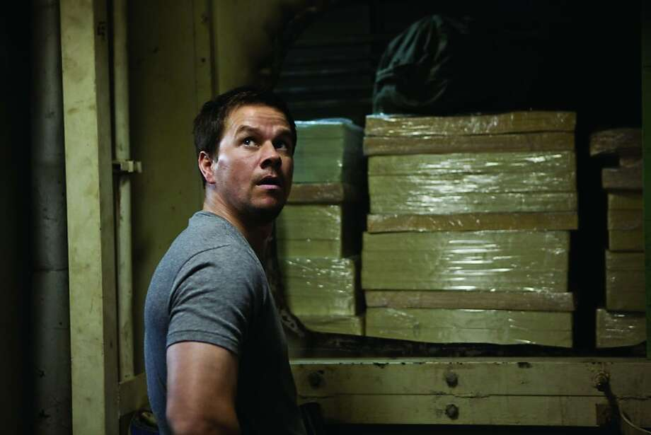 "Mark Wahlberg stars in ""Contraband"" (2012). MARK WAHLBERG leads the cast as Chris Farraday in ?Contraband?, a white-knuckle action-thriller about a man trying to stay out of a world he worked hard to leave behind and the family he?ll do anything to protect. Photo: Universal Pictures"
