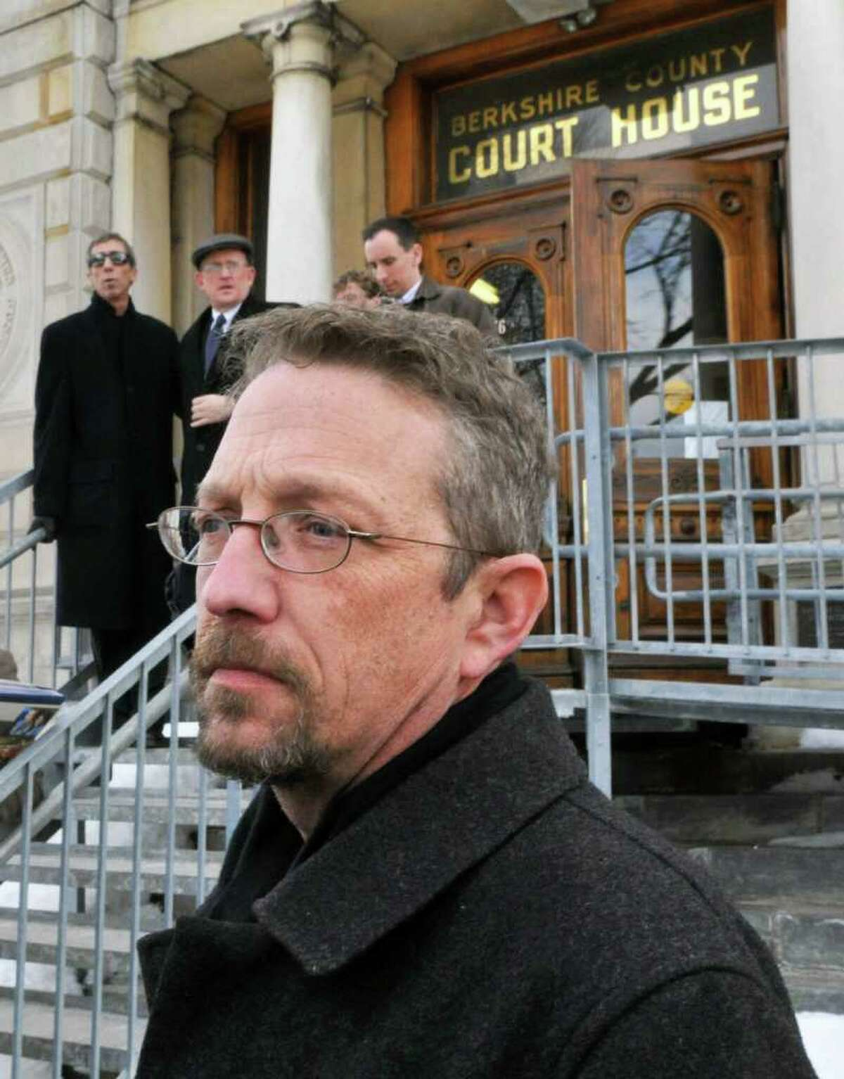 Abuse victim Michael Flynn of Watervliet stands outside a Berkshire County courthouse last year following the sentencing of former priest Gary Mercure for raping altar boys in the 1980s. Flynn, who was a victim of Mercure's, attended St. Teresa of Avila elementary school in Albany. Flynn said a school janitor accused of sexual abuse had exposed himself to Flynn, then in elementary school, during an unsettling encounter in a locker room. (John Carl D'Annibale / Times Union)