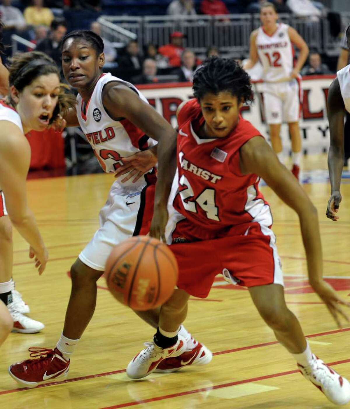 Fairfield University's #23 Taryn Johnson and Marist's #24 Carielle Yarde, right, go for a rebound, during womens basketball action at the Webster bank Arena in Bridgeport, Conn. on Thursday January 12, 2012.