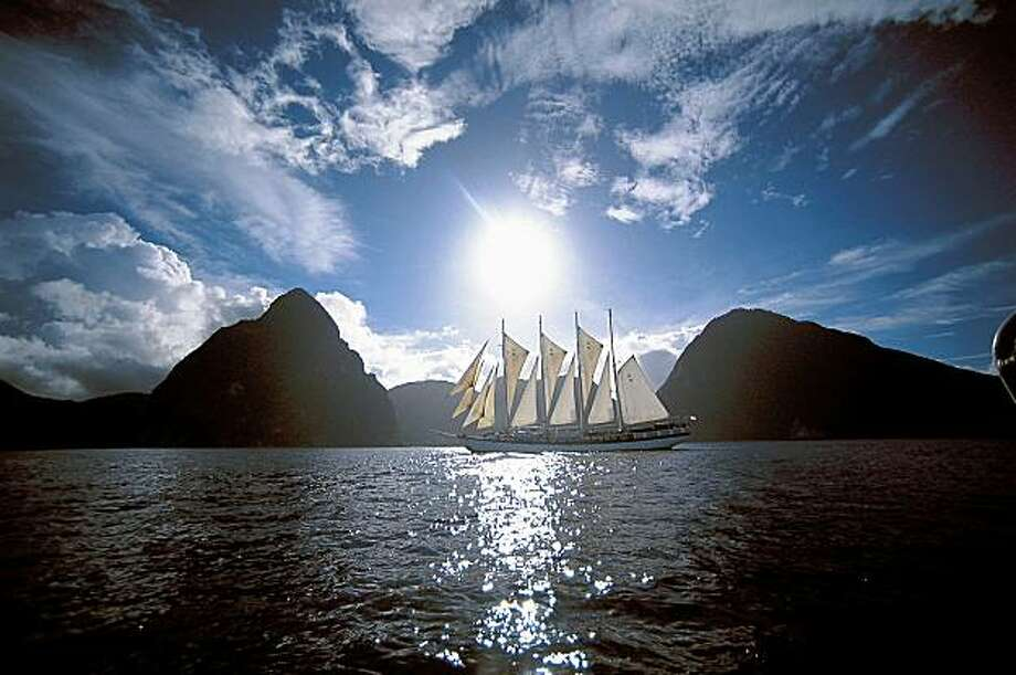 This undated photo provided by Windjammer Barefoot Cruises shows the Windjammer ship Polynesia sailing in between the Twin Pitons of the Caribbean island of St. Lucia. Photo: WINDJAMMER BAREFOOT CRUISES, AP