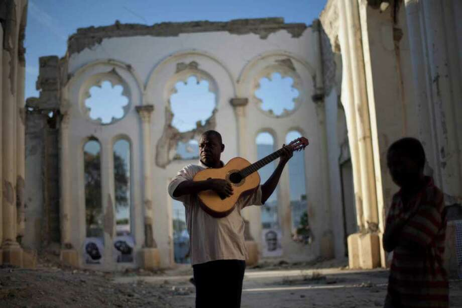 Haitians gathered Thursday to mark the second anniversary of the devastating 2010 earthquake, holding ceremonies at various places throughout the country, including a damaged cathedral in Port-au-Prince. Photo: Ramon Espinosa / AP