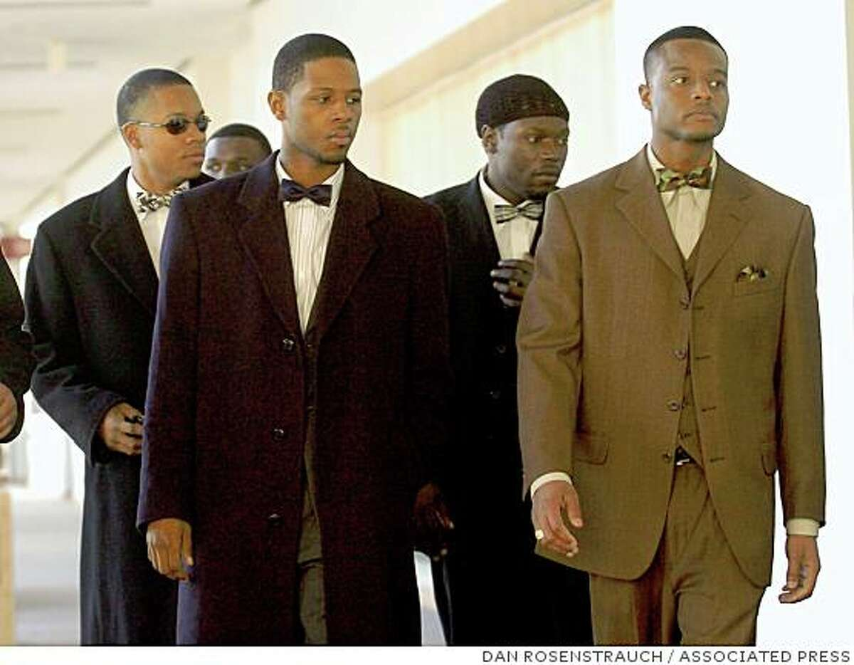 Yusuf Bey IV, 19, left, and Kahlil Ali Raheem, 24, right, walk into Dept. 112 of the Wiley Manuel Courthouse in Oakland, Calif., Thursday Jan. 12, 2006. Bey and Raheem plead not guilty to allegedly entering a corner store, in Oakland and shattering refrigerator cases and smashing bottles of liquor, wine and beer, as well as terrifying the clerk. Bey and five other men were in court Thursday, to plead in the Nov. 23, 2005 attack.
