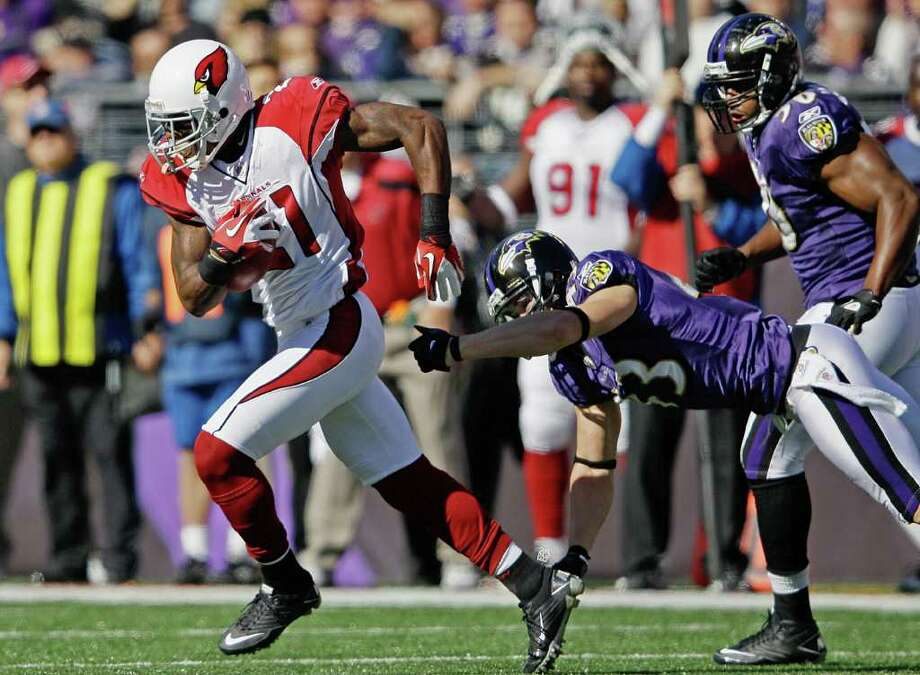 Arizona Cardinals cornerback Patrick Peterson, left, breaks free from Baltimore Ravens defensive back Haruki Nakamura to return a punt for a touchdown during the first half of an NFL football game in Baltimore on Sunday, Oct. 30, 2011. (AP Photo/Patrick Semansky) Photo: Patrick Semansky / AP