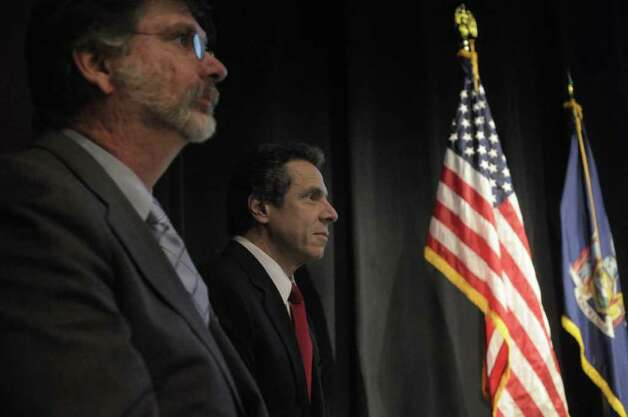 New York State Budget Director Robert Megna, left, and  Governor Andrew Cuomo, right, listen from the side as Lieutenant Governor Bob Duffy addresses those gathered to hear the Governor's  budget address in the Hart Theater at The Egg in Albany, NY on Tuesday, Feb. 1, 2011.  (Paul Buckowski / Times Union) Photo: Paul Buckowski / 00011924A