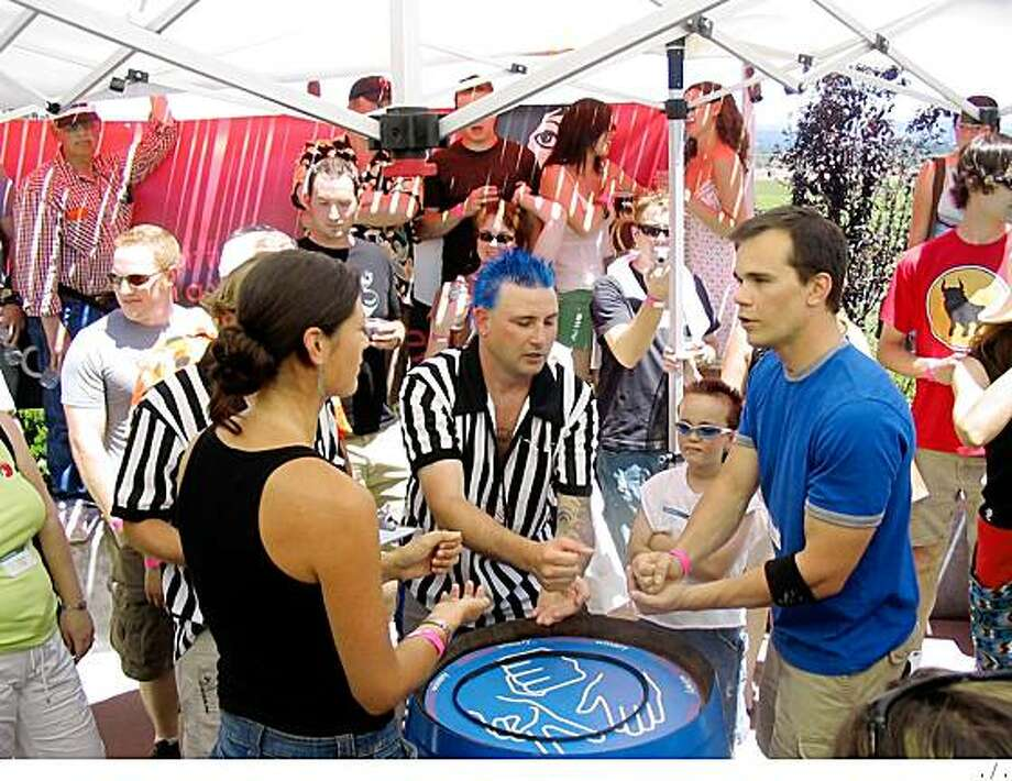 Paper beats rock: Challengers face off in last year's RockPaperScissors Championship. Photo: .