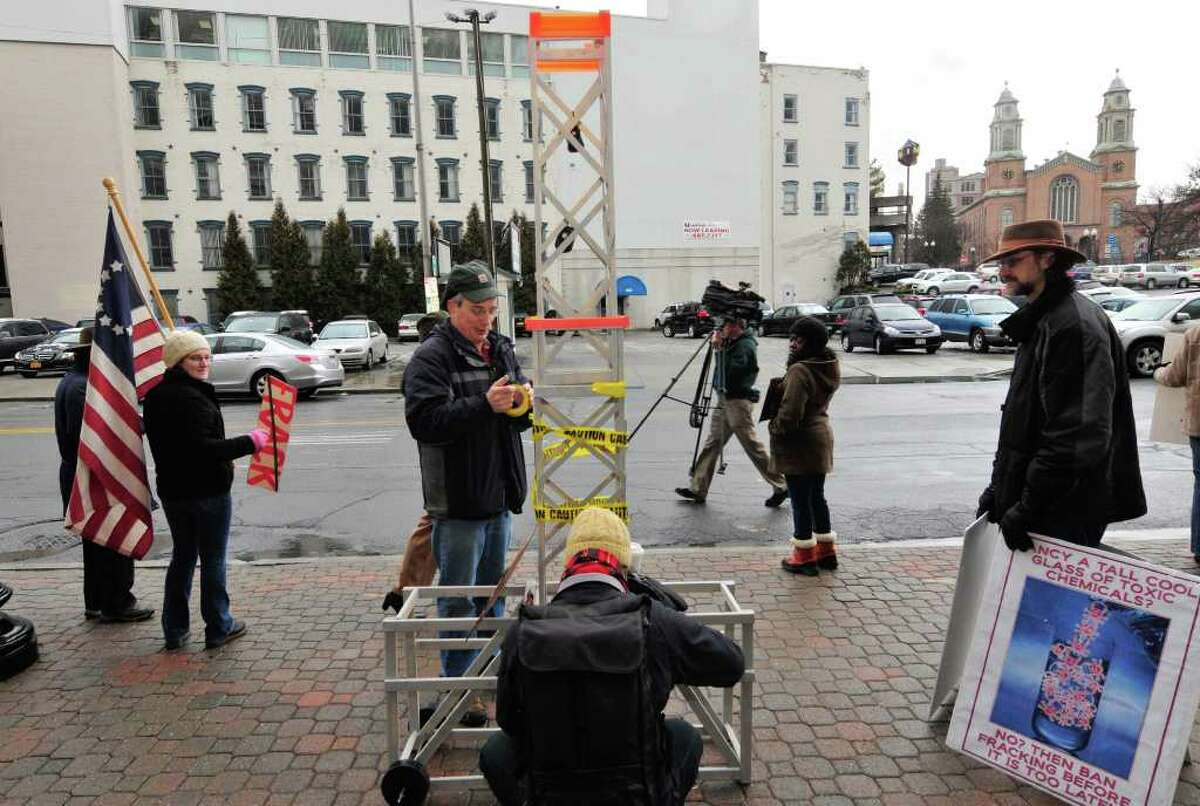 Anti-fracking demonstrators organized by Occupy Albany protest in front of the DEC building in Albany,NY Thursday, Jan.12, 2012. ( Michael P. Farrell/Times Union)