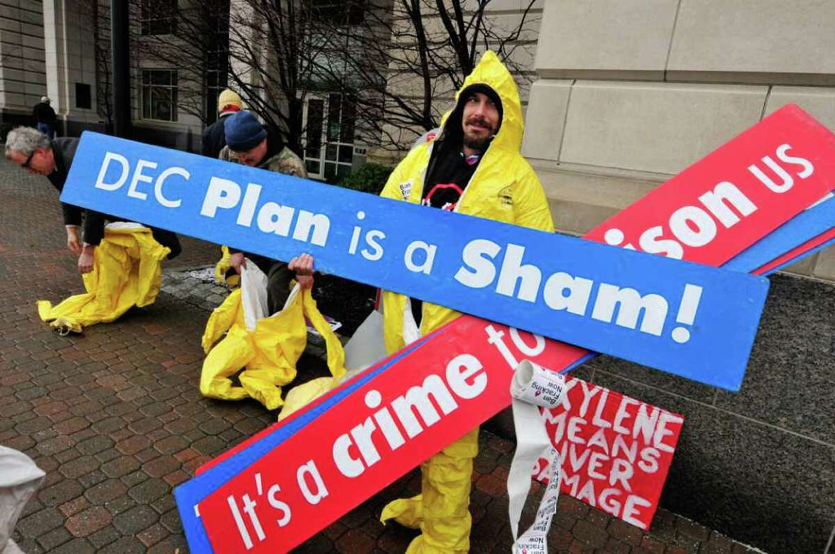 Abram Loeb of Afton dressed in a decontamination suit joins anti-fracking demonstrators organized by Occupy Albany protest in front of the DEC building in Albany,NY Thursday, Jan.12, 2012. ( Michael P. Farrell/Times Union)