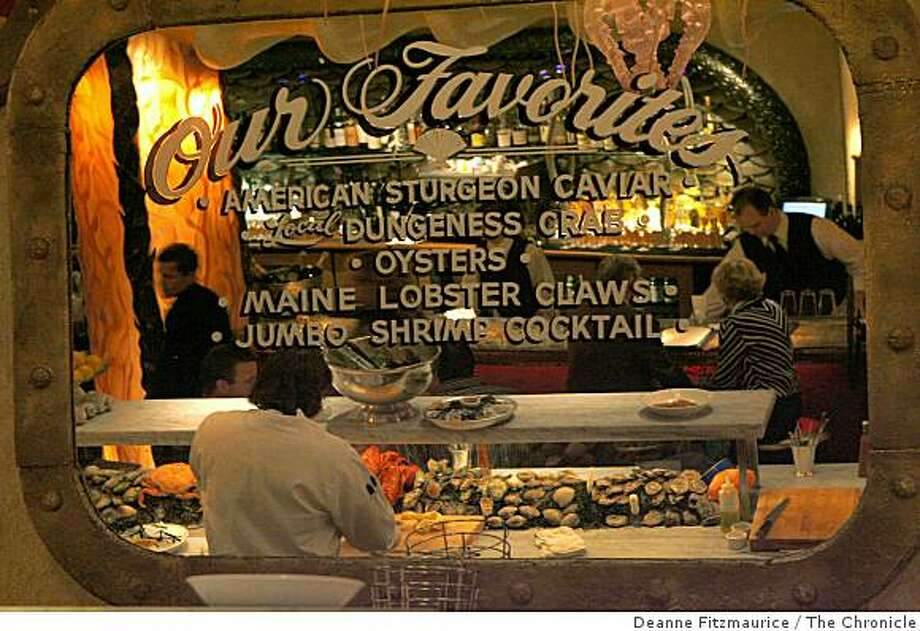 At Farallon, a mirror above the oyster bar offers customers a chance to reflect upon some top choices among the seafood offerings. Also worth trying are pastry chef Emily Luchetti's dazzling seasonal desserts. The Post Street restaurant serves dinner only. Photo: Deanne Fitzmaurice, The Chronicle