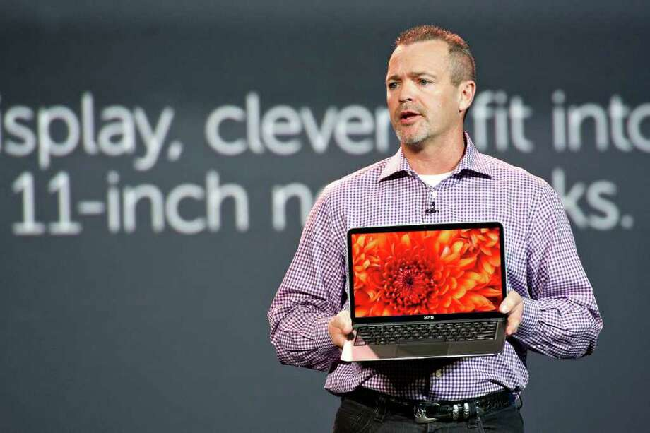 Jeff Clarke of Dell displays an XPS 13, part of the trend of  making devices more stylish, at the International Consumer Electronics Show. Photo: Daniel Acker / © 2012 Bloomberg Finance LP