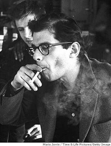 Content Date:   1/1/1960 Beat poet Allen Ginsberg (pre - beard) taking drag on cigarette. (Photo by Mario Jorrin/Pix Inc./Time Life Pictures/Getty Images) Ran on: 10-03-2007 Lawrence Ferlinghetti first published &quo;Howl.'' He says he sees the present situation &quo;as a repeat in spades of what happened in the 1950s.'' Ran on: 10-03-2007 Lawrence Ferlinghetti first published &quo;Howl.'' He sees FCC pres- sure on broadcasters as &quo;a repeat in spades of what happened in the 1950s.'' Photo: Mario Jorrin, Time & Life Pictures/Getty Image