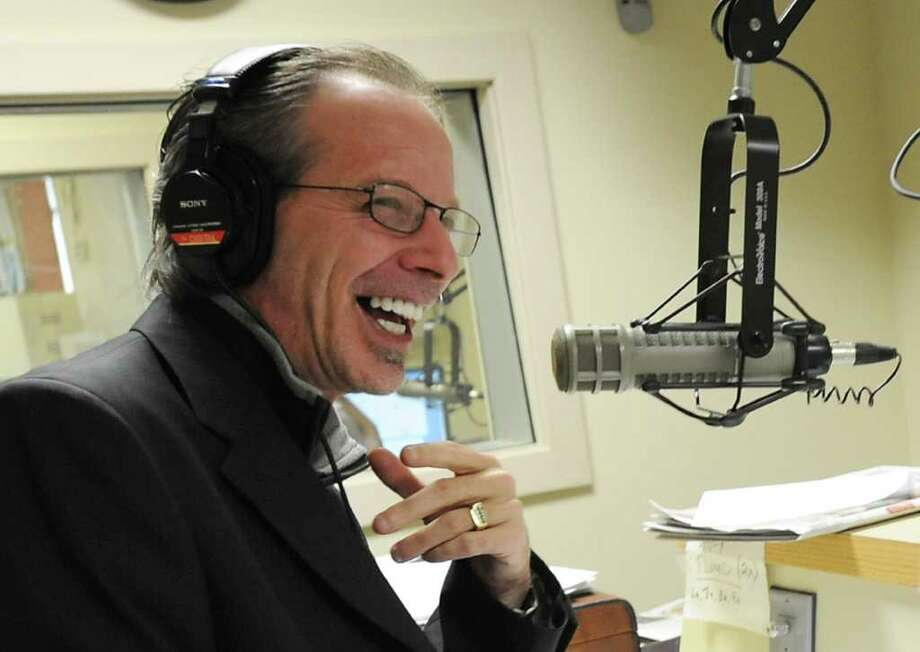 Bruce Jacobs, afternoon drive-time talk show host at the ESPN affiliate in Albany, talks on-air  at his job Wednesday, Jan. 11, 2012 in Schenectady, N.Y.  (Lori Van Buren / Times Union)l Photo: Lori Van Buren