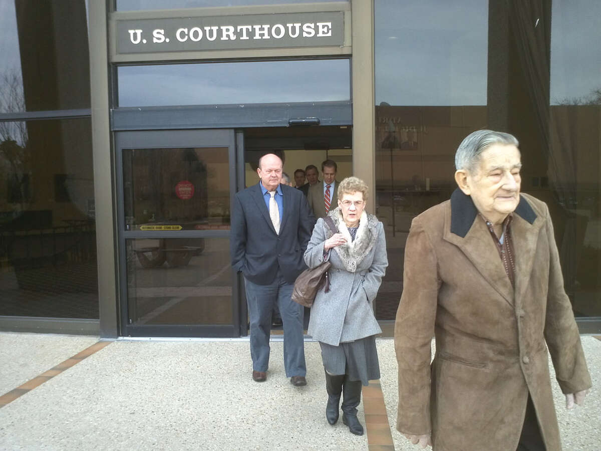 Eisenhauer flea market owner Bruce Gore (from left) and manager Pat Walker (in gray coat), and Walker's husband, Bob, leave federal court on Thursday, Jan. 12, 2012. A federal jury found Gore and Pat Walker contributed to trademark infringement for allowing vendors to sell knockoff items depicting the Louis Vuitton brand.