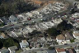 Fire crews search through the rubble of homes in San Bruno, Calif. on Friday, Sept. 10, 2010 that were destroyed by a massive natural gas pipeline explosion Thursday night.