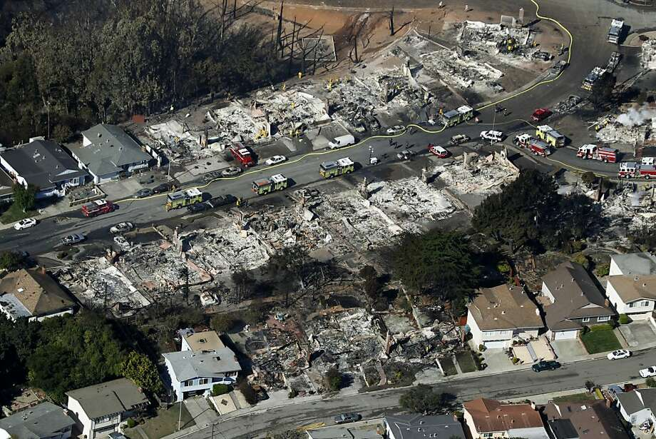 Fire crews search through the rubble of homes in San Bruno, Calif. on Friday, Sept. 10, 2010 that were destroyed by a massive natural gas pipeline explosion Thursday night. Photo: Paul Chinn, The Chronicle