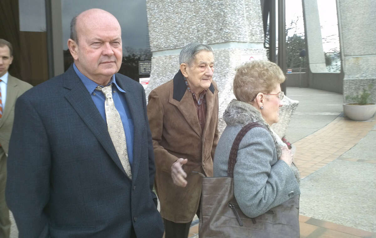 Eisenhauer flea market owner Bruce Gore (from left) leaves court with manager Pat Walker (in gray coat) and her husband, Bob. A federal jury found Gore and Pat Walker contributed to trademark infringement for letting vendors sell knockoff products depicting Louis Vuitton. The jury awarded Louis Vuitton $3.6 million.