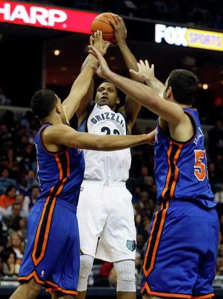 Memphis Grizzlies forward Rudy Gay, center, shoots over New York Knicks defenders Landry Fields, left, and Josh Harrellson (55) in the second half of an NBA basketball game on Thursday, Jan. 12, 2012, in Memphis, Tenn. Photo: AP