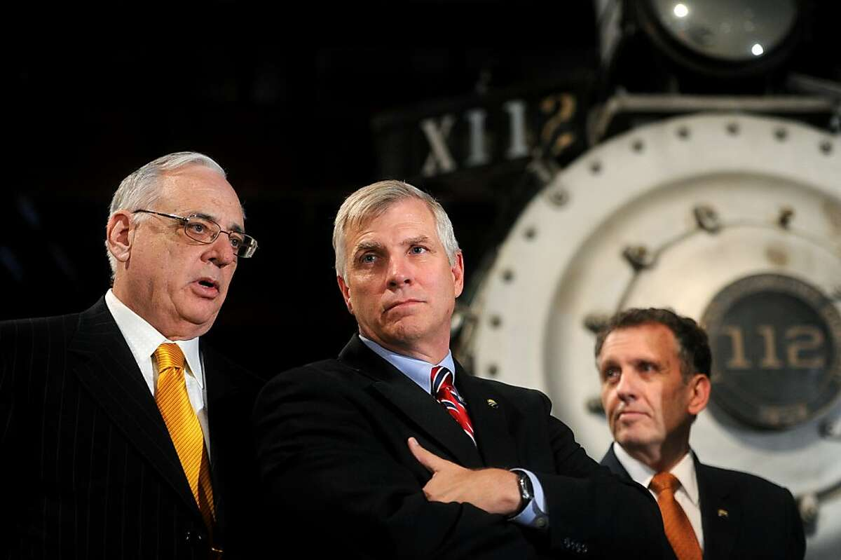High speed rail proponents field questions during a news conference on Tuesday, Nov. 1, 2011, at the Sacramento, Calif., California State Railroad Museum. From left to right are California High Speed Rail Authority boardmember Dan Richard, chairperson Thomas Umberg and CEO Roelof van Ark. In a business plan released Tuesday, the group raised its projected cost to approximately $98 billion, more than double the last estimate.