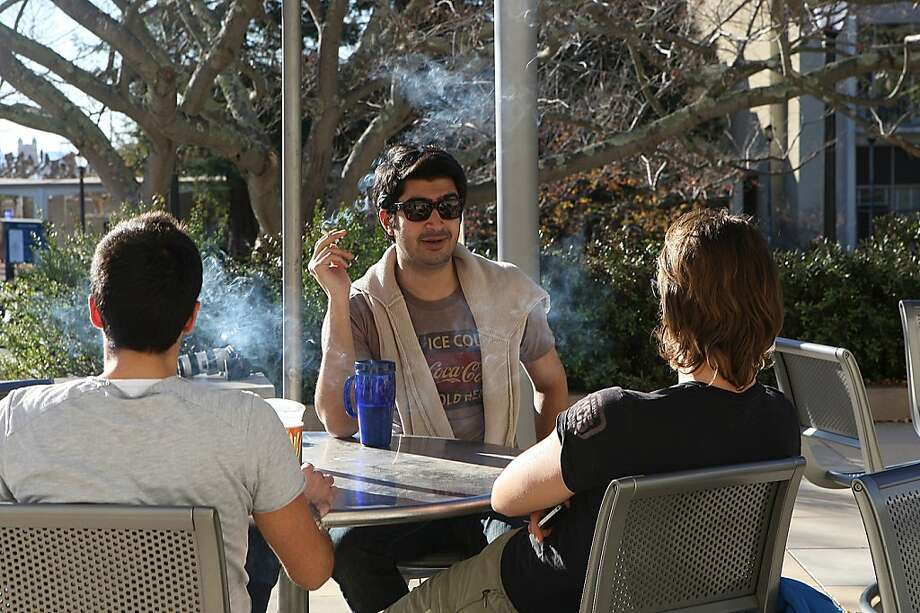 Manos Chamilothoris (left), Hasnain Bokhari (middle), and Matteo Carraro (right), students studying for a masters in law, smoke in front of Boalt Hall at the UC Berkeley campus in Berkeley, Calif., on Thursday, January 12, 2012.  Starting in 2014 smoking will not be allowed anywhere on a UC campus. Photo: Liz Hafalia, The Chronicle