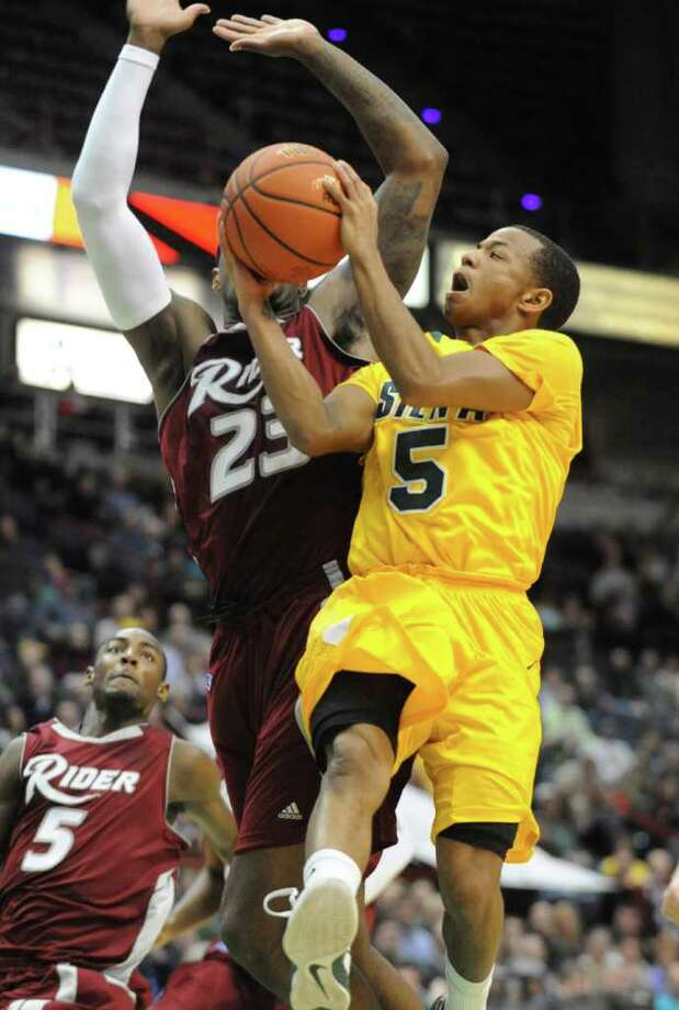 Siena's Evan Hymes drives to the basket against Novar Gadson of Rider during a MAAC basketball game at the Times Union Center Thursday, Jan 12, 2012 in Albany, N.Y.  (Lori Van Buren / Times Union)l Photo: Lori Van Buren