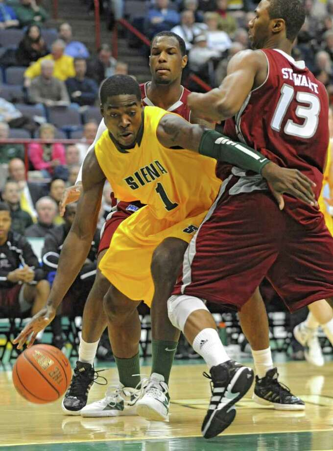Siena's OD Anosike drives to the basket past Daniel Stewart of Rider during a MAAC basketball game at the Times Union Center Thursday, Jan 12, 2012 in Albany, N.Y.  (Lori Van Buren / Times Union)l Photo: Lori Van Buren