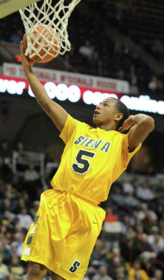 Siena's Evan Hymes makes a layup from a fast break during a MAAC basketball game against Rider at the Times Union Center Thursday, Jan 12, 2012 in Albany, N.Y.  (Lori Van Buren / Times Union)l Photo: Lori Van Buren