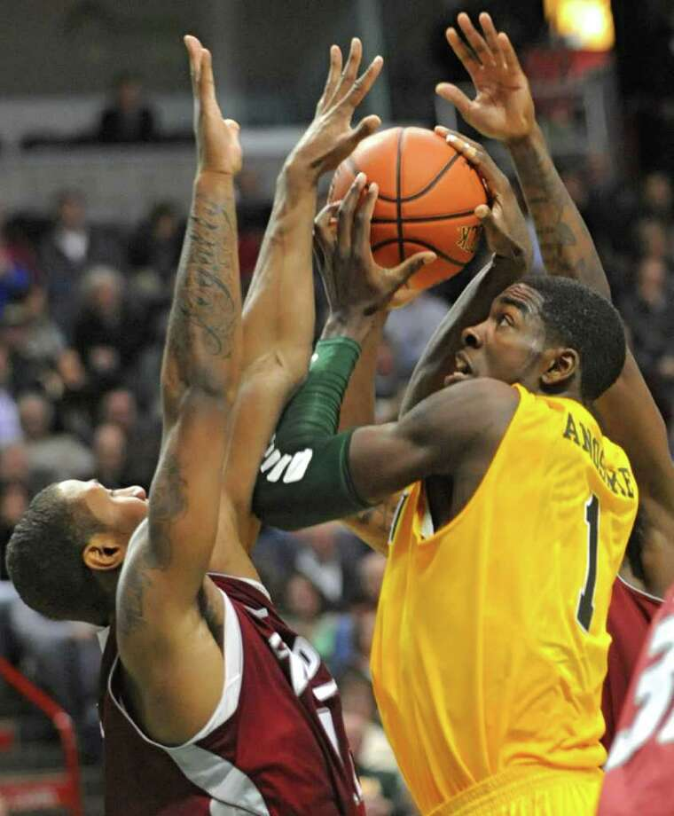 Siena's OD Anosike drives to the basket during a MAAC basketball game against Rider at the Times Union Center Thursday, Jan 12, 2012 in Albany, N.Y.  (Lori Van Buren / Times Union)l Photo: Lori Van Buren