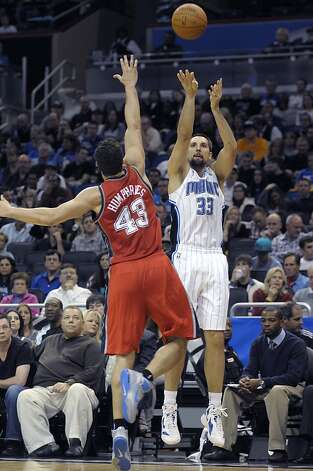 Orlando Magic forward Ryan Anderson, right, goes up for a shot in front of New Jersey Nets forward Kris Humphries during the first half of an NBA basketball game in Orlando, Fla., Thursday, Dec. 29, 2011.(AP Photo/Phelan M. Ebenhack) Photo: Phelan M. Ebenhack, Associated Press