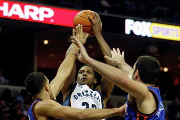 Memphis' Rudy Gay, center, proves he's double trouble for double coverage. Gay has no problem getting his shot off over New York defenders Landry Fields, left, and Josh Harrellson in the second half for two of his game-high 26 points.
