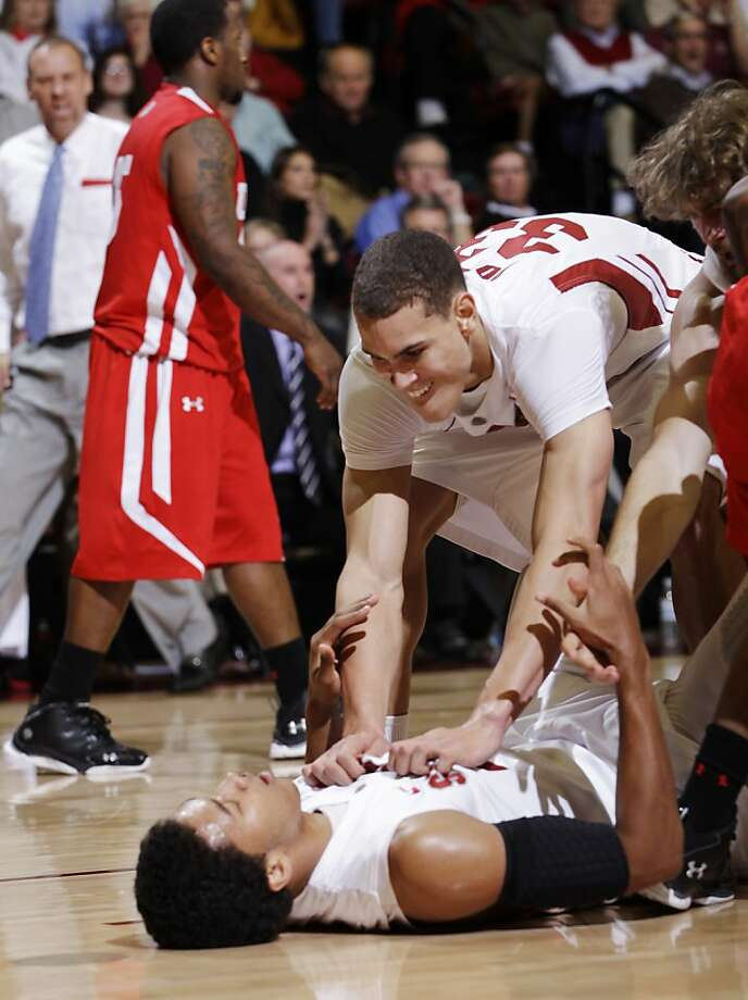 Stanford forward Josh Huestis is congratulated by forward Dwight Powell (33) after Huestis scored against Utah in the second half of an NCAA college basketball game in Stanford, Calif., Thursday, Jan. 12, 2012. Stanford defeated Utah 68-65. Huestis was Stanford's high scorer with 13 points. (AP Photo/Paul Sakuma) Photo: Paul Sakuma, Associated Press