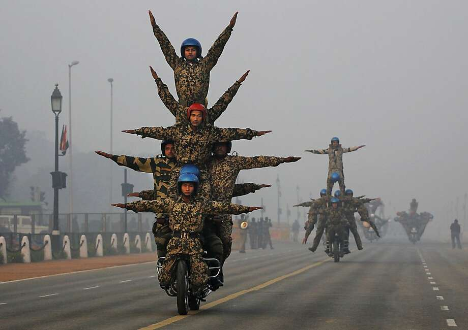 The guy controlling the handlebars is the only one who can't see where he's going:Indian soldiers practice motorcycle stunts in preparation for an upcoming Republic Day parade in New Delhi. Photo: Kevn Frayer, Associated Press