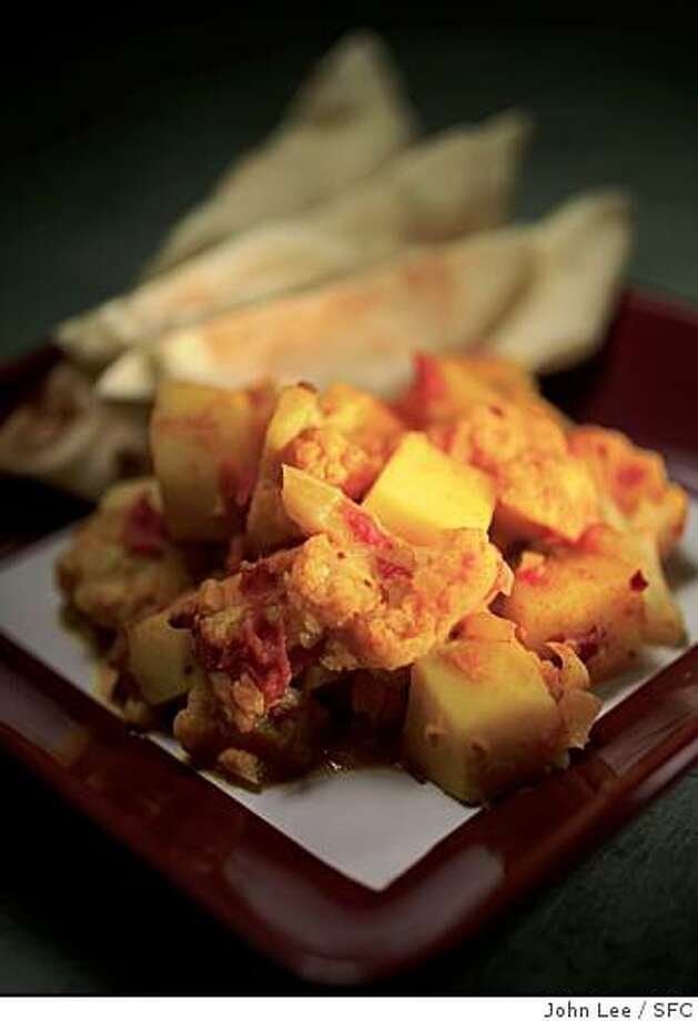 Aloo Gobi, or Indian spiced cauliflower with potatoes and rice. Photo: John Lee, SFC